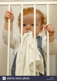 Baby Stairgate A Baby Trying To Open A Safety Stair Gate Stock Photo Royalty