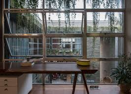 reclaimed windows and doors form facades of collage house