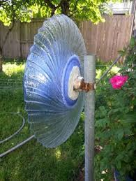 how to attach a glass garden flower to a pole outdoors