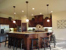 custom kitchen island kitchen with dark cabinetry with rounded