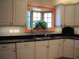cute small kitchen design and decoration with black glass tile