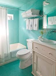 bathroom ocean blue glass tile with wall mounted faucet and white