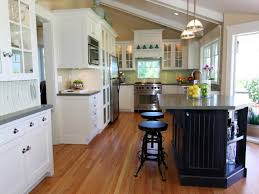 modern traditional kitchen with vaulted ceiling and white cabinets
