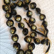 kukui nut 32 black gold kukui nut from auntie judy s closet on poshmark