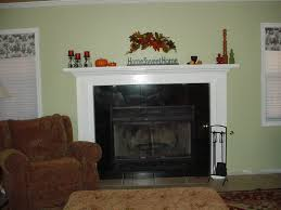 white concrete decorating ideas of fireplace on green wall paint