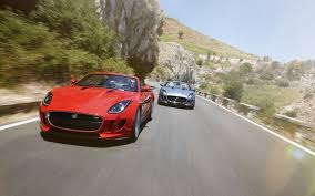 two jaguar f type traveling on a mountain road pictures f tour