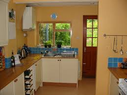 orange wall kitchen room paint colors with cream cabinet can add