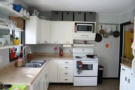 tips for decorating above kitchen cabinets amys office
