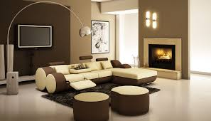 l shaped cream brown leather sofa having cushions and round cream