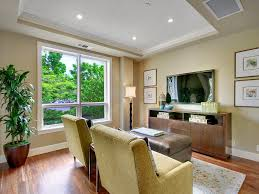 Recessed Baseboards by Tv Wall Mount And Sofa Orange Living Room Wood Ceiling Eclectic