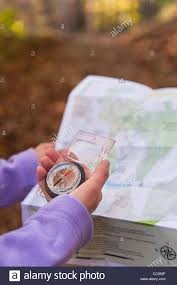 Map Of Usa With Compass Usa New Jersey Close Up Of Woman U0027s Hands Holding Compass And Map