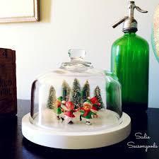 diy christmas wreath ornament from a repurposed mason jar lid