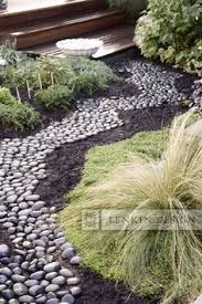 beautify your outdoor place with 12 dry river bed landscaping made