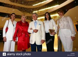ivana trump and vladimir kraljevic pose in the foyer of hotel lone