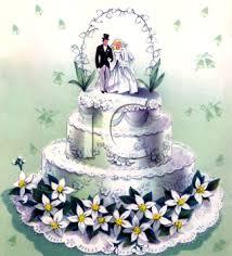 vintage wedding design of bride and groom cake topper on a wedding
