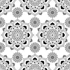 seamless pattern background with black and white mehndi henna lace
