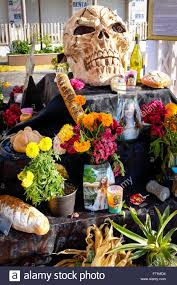 skull flowers and food included in an alter for the festival of