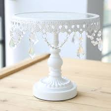 glass cake stand with fondant cake decorating tools