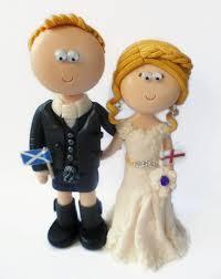 a cheeky view of a scottish kilt wedding cake topper kilts