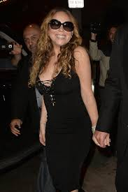 mariah carey suffers a nip slip as she busts out of tiny black