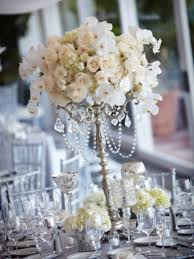 Wedding Centerpieces With Crystals by Silver Candlestick Piece With A Center Arrangement To Compliment