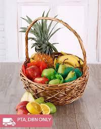 fruit in a basket buy tropical fruit basket online netflorist