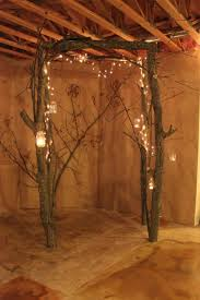 wedding arbor used arch made from small tree trunks and branches used white lights
