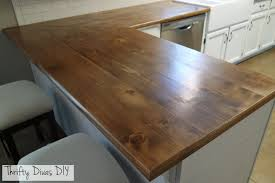 thrifty divas diy wide plank butcher block countertops kitchen ditch your old worn out laminate counters and swap them out for some new diy wide plank butcher block counters instead