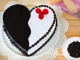 cake photos heart shaped choco vanilla cake heart licious pleasure cake bakingo