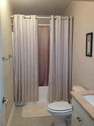Bathroom Curtain Ideas Pinterest by Hanging Shower Curtains To Make Small Bathroom Look Bigger