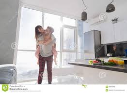 modern asian kitchen young couple in kitchen lovers hispanic man carry asian woman