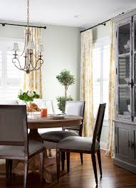 plantation shutters with curtains dining room traditional with