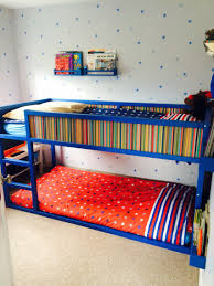 ikea kura bed turned into bunk bed using extra slats on the bottom