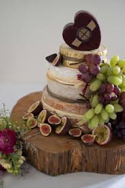 wedding cake of cheese cheese accompanied by sweet figs are a match made in cheesy heaven