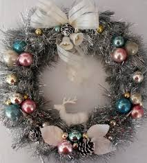 glittering silver tinsel wreath with vintage ornaments by oodles