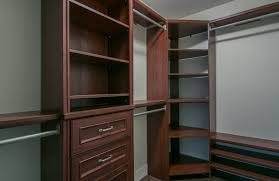 dark brown wooden corner closet shelves with drawers and graded