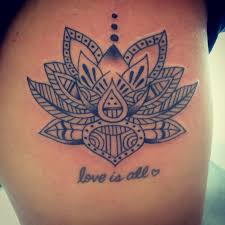 tribal lotus flower and is all letteringtattoo