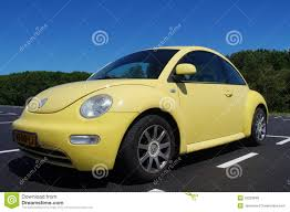 yellow volkswagen beetle royalty free yellow volkswagen beetle side front view editorial stock image