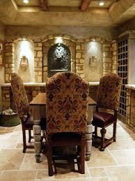 tuscan style dining room with decorative walls with built in wine
