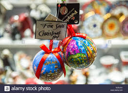 baubles of sale in a shop window stock photo 165313034