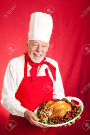 thanksgiving stuffed chef holding a thanksgiving or christmas turkey stuffed on a
