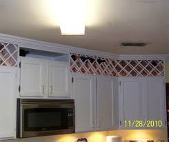 kitchen cabinet top storage 20 stylish and budget friendly ways to decorate above