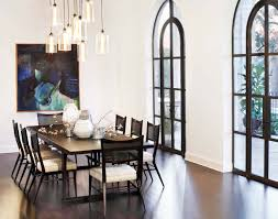 contemporary dining room with droplet crystal chandelier and