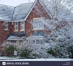 winter snowing red house trees covered with snow stock photo