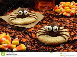 halloween spider cookies on orange and black background stock