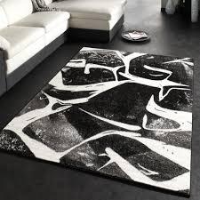 teppich mit sternen designer teppich mit konturenschnitt wellen muster schwarz grau