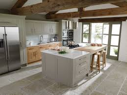 island in small kitchen light grey on island but light brown of cabinetry has white