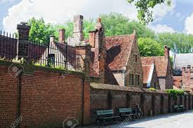 european small street with old brick houses bruges belgium