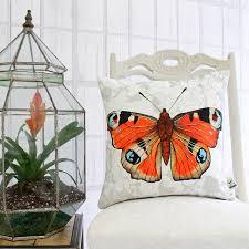 peacock butterfly botanical floral print cushion by terrarium