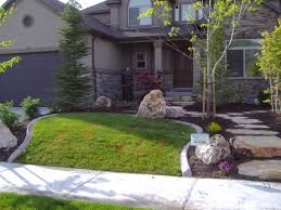 outstanding stone landscaping ideas with enchanting grass pathway in small garden ideas with beautiful and